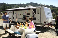 Family at a picnic table next to their RV