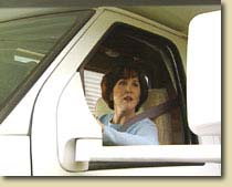 Lady driving an RV Rental vehicle